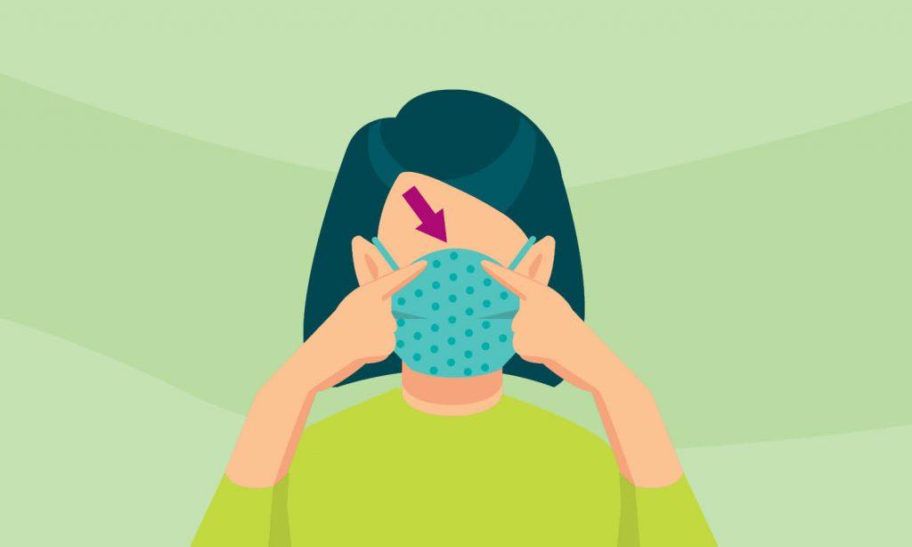 Ce visuel montre une personne portant correctement un masque en tissu artisanal. Un élastique est fixé à chaque extrémité du masque et peut être passé sur les oreilles pour le maintenir en place. Assurez-vous que votre masque couvre complètement votre nez et votre bouche.
